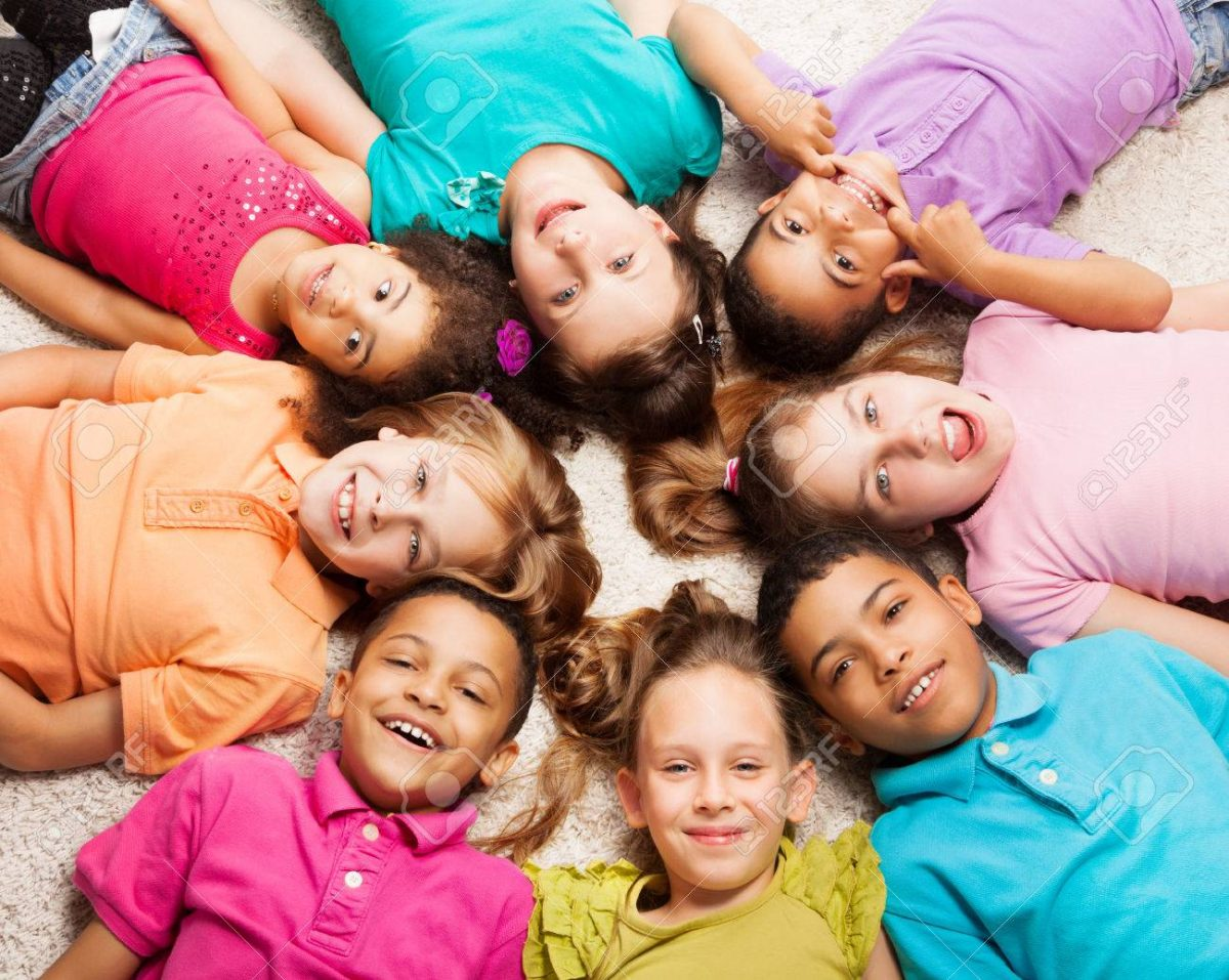 22511678-group-of-eight-happy-diversity-looking-kids-boys-and-girls-laying-in-star-shape-on-the-floor-1200x957.jpg